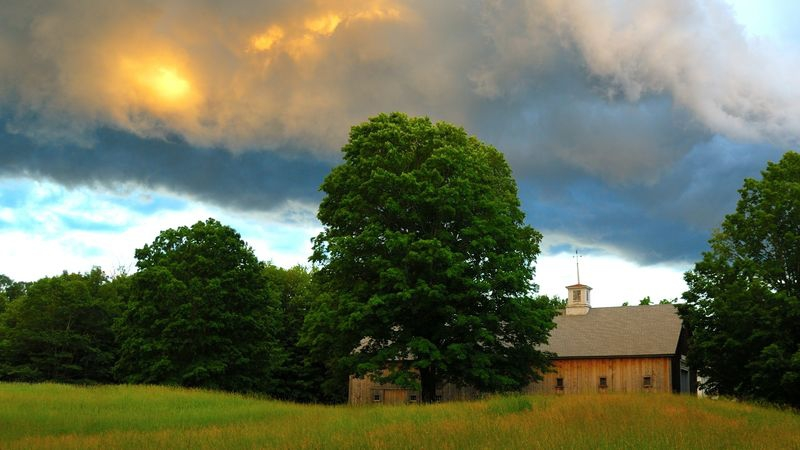 Long Barn in a summer storm