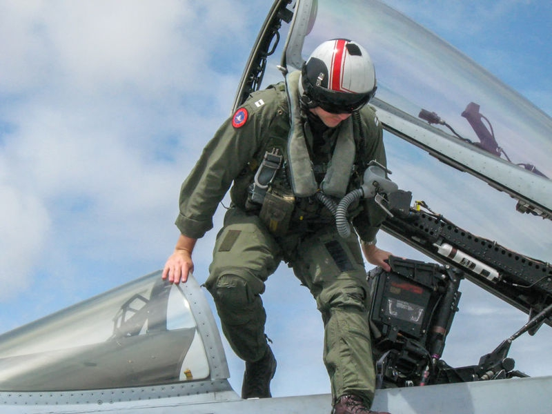 Navy pilot egressing F/A-18 Hornet