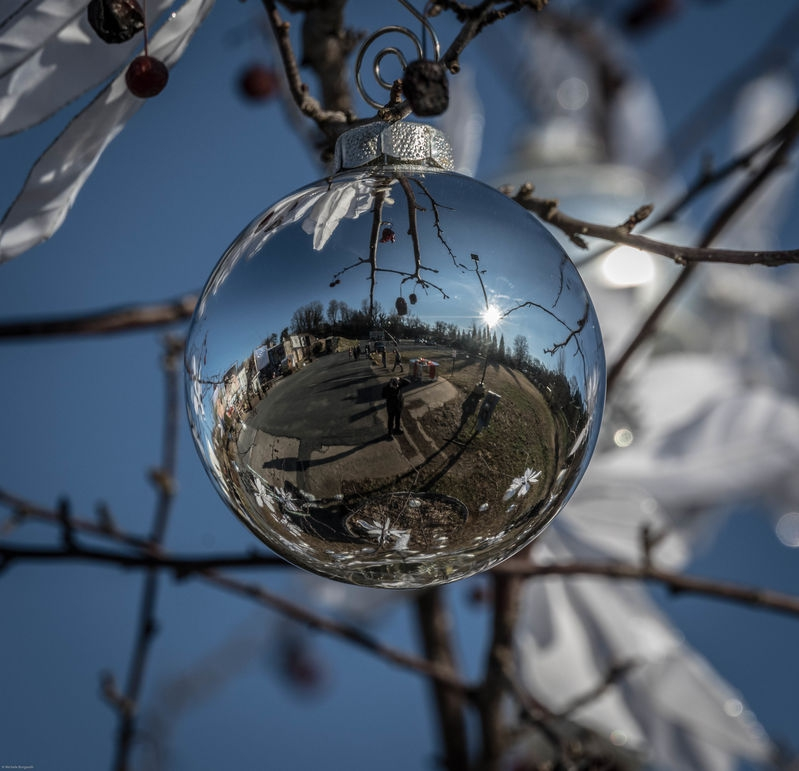 District IX Art Park Charlottesville reflected in a Christmas ball