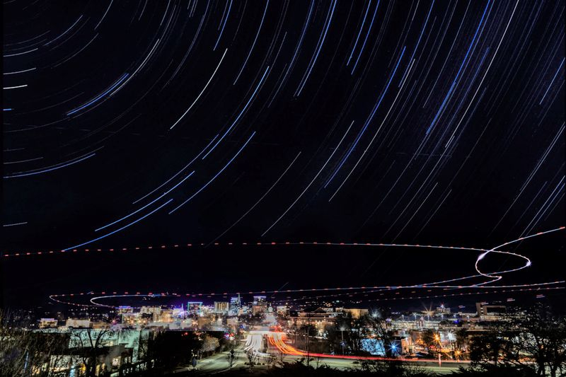Nightscape with star trails and helicopter lights